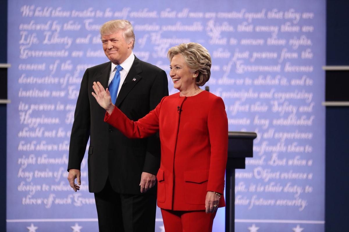 Clinton, Trump press pointed attacks in debate