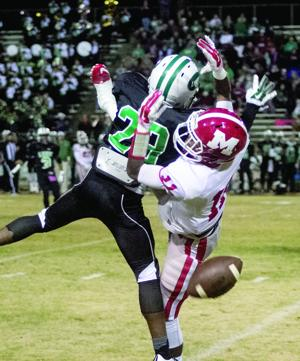 """<p dir=""""ltr"""" align=""""justify"""">Leeds defensive back Torrence Pollard breaks up a pass intended for Munford's James Jenkins during state high school football quarterfinal action Friday.</p>"""
