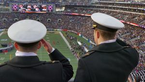 <p>Navy midshipmen salute as the national anthem plays during the 115th Annual Army-Navy game. Navy enjoyed a bowl win this year as well. (Karl Merton Ferron/Baltimore Sun/TNS)</p>