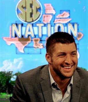 <p>Analyst Tim Tebow smiles as media members enter the SEC Nation studio earlier this season.</p>