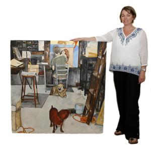 <p>Allison McElroy poses with one her favorite paintings.</p>