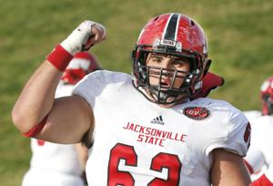 <p>Jacksonville State center Max Holcombe celebrates during the Gamecocks' victory at Eastern Kentucky this season.</p>