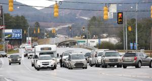 <p>Traffic on Leon Smith Parkway near the Oxford Exchange on Wednesday.</p>