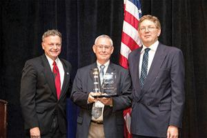 <p>James A. Kesteloot, vice chairperson of the U.S. AbilityOne Commission, and J. Anthony Poleo, chairperson, present Alabama Industries for the Blind Executive Director Billy Sparkman with the U.S. AbilityOne Commission Chairperson's Award for Excellence. Sparkman has served AIB for more than four decades.</p>