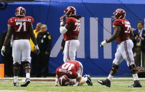 <p>Alabama quarterback AJ McCarron (10) hangs his head on the field after he fumbled and Oklahoma scored to seal the win for the Sooners in last season's Sugar Bowl in New Orleans.</p>