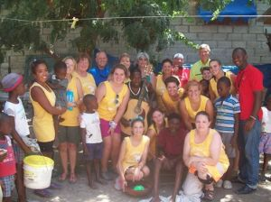 <p>Acteens and chaperones from Sylacauga with new friends in Haiti.</p>