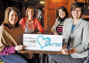 <p>Four longtime friends are kicking off 100 Women Who Care of the Greater Owosso Area, an organization that aims to give $30,000 to deserving area agencies every year. The pals are shown, from left, Wednesday at Guido's Coffee Lounge in Owosso: Lisa Hood of Owosso, Cindy Schluckebier of Owosso Township, Becky Hartnagle of Chesaning and Sue Ludington of Owosso.</p>