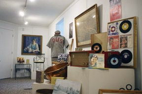 "<p>HISTORICAL ARTIFACTS, including 45 RPM records from the American Record Pressing Company, a bowl from the Sugar Bowl candy store and baseball bats from Zimmerman Bat Company, will be on display at the ""Made in Owosso"" exhibit opening June 24. The items are pictured Thursday at the Shiawassee Arts Center.</p>"