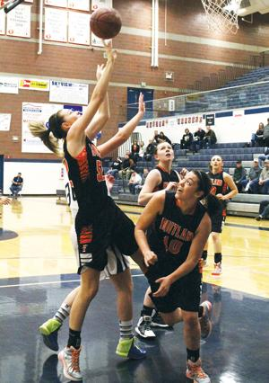 <p>Brooke Teunissen from Fruitland sends the ball home during a state tournament game against Timberlake Feb. 19. Fruitland dropped the opening round game, 43-47, but won its next two to take home the state 3A consolation trophy.</p>