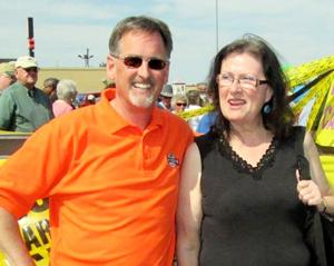 <p>Mike Hanigan, owner of Hanigan Dealerships, is shown with Karen Hatfield of Council. Hatfield won a pickup truck from the dealership.</p>