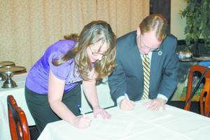 Community school, EOU officials formalize existing partnership