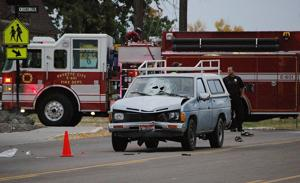 <p>A pickup truck sits in the middle of U.S. 95 shortly after it struck a 13-year-old boy Thursday morning. A Life Flight helicopter took the boy, who is in critical condition, to Saint Alphonsus Regional Medical Center in Boise. His shoes are visible behind the pickup.</p>
