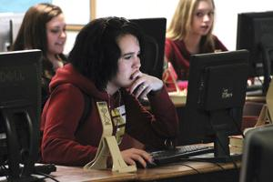<p>From left, Payette High School students Marissa Limary, Ashley Polk and Annika Davis work in Duane Higley's interactive media class, one class of many that rely on the Internet.</p>