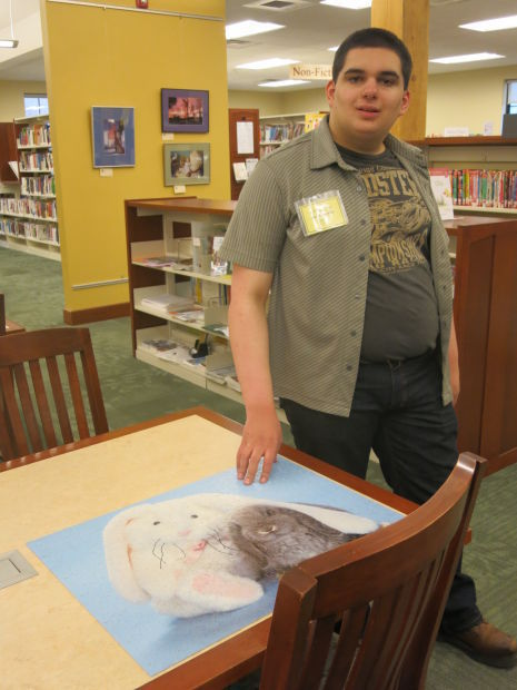 'Big ideas': Marcellus Free Library volunteer shows off talents in art, literature, puzzles