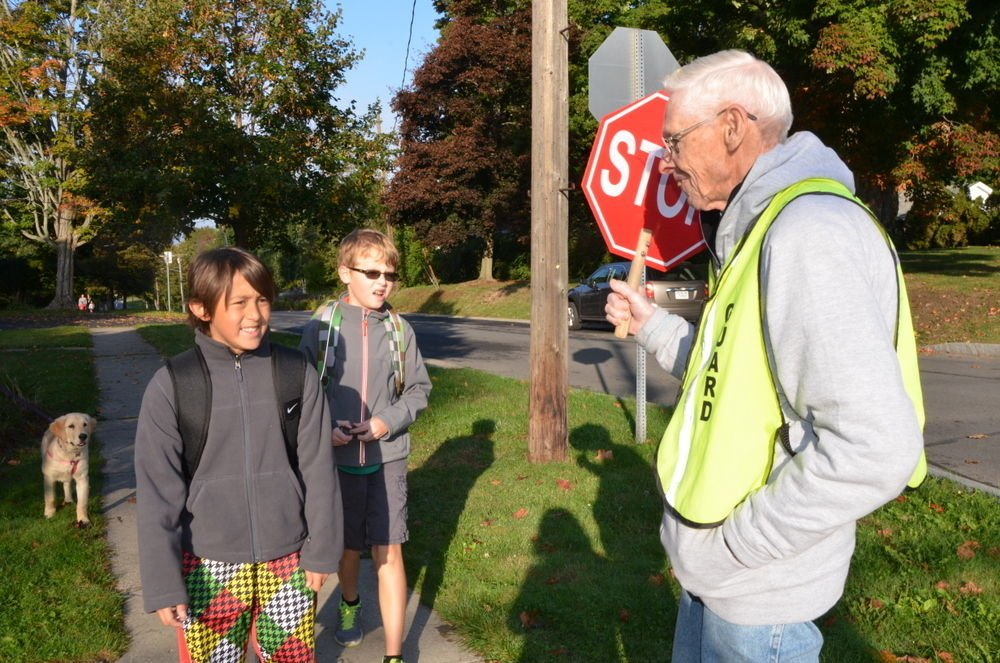 Crossing guards Clint Woodford, Jim Brown help Skaneateles elementary students walk safely