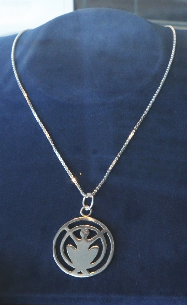 Powerful pendants auburn woman crafts inspirational for Terry pool design jewelry