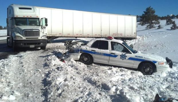 Semitruck pummels in to patrol car Injures officer