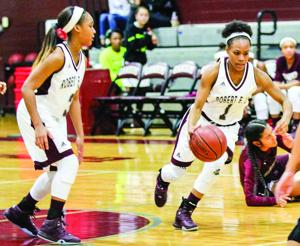 <p>Robert E. Lee High School's LyLy McCovery dribbles the ball down the court against Northbrook during a Lady Ganders' victory this season.</p>