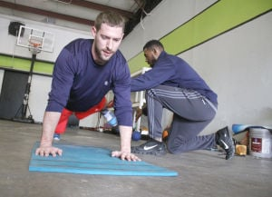 <p>Former Robert E. Lee quarterback and current Calgary Stampeder Drew Tate works out with high school teammate Michael Reed at his North Main Street facility.</p>