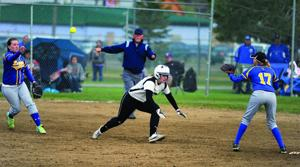 <p>Belgrade's Hannah Goulet dives back into second base after getting caught in a run down during seventh inning action Thursday against Libby at the State A tournament. The senior wound up at third thanks to an over throw by Libby.</p>