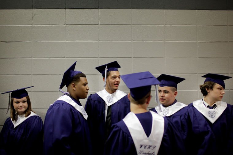 Photo by Nathan Morgan/Daily News Graduates line up before the start ...