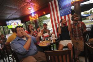 Local group of fans all-in to support the U.S.