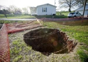 Another sinkhole near Bowling Green, KY is thirty feet deep...