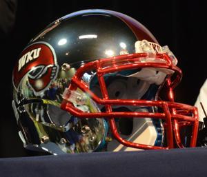 Petrino shows off new WKU football helmet