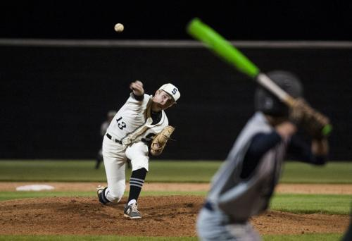 Harnage overcomes Spartans' defensive woes in district win
