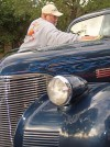 John Lien polishes his '39 Chevy
