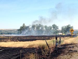 Grass fire east of Laurel sends smoke column above I-90