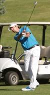 Nathan Baily hits a fairway shot