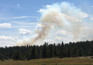 Small wildfire burning near Roundup