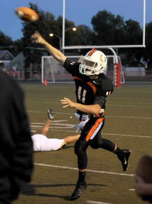 Nathan Dick throws a pass