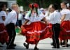 Children from the Los Guadalupanos dance group entertain