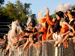 Senior students toss baby powder in the air