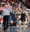 Colstrip's Austin Blaede helps Forsyth's Brandon Weber celebrate