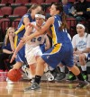 Townsend's Jacy Thompson, 24, drives with the ball