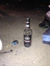 A bottle of vodka at the scene of the crash