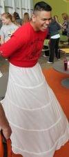 Marcos Mota tries on a hooped dress