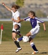 Senior's Alex Harvey, left, and Butte's Emily Cleverly battle for the ball