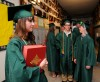 Aubree Trunkle carries the Bible as graduates gather