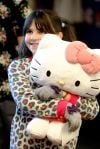 Kaitlyn Cermak hugs her new Hello Kitty doll