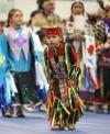 A young boy dances
