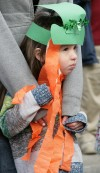 Ryalia Ziler, age 4, watches the St. Patrick's Day Parade