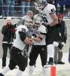 Dan Moore (35) celebrates his touchdown