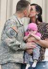 Michael Sherwood kisses his wife Sharon