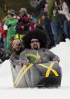 Racers dressed as the Jamaican bobsled team