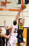 Jared Samuelson of West and Nickos Vlahos of Senior reach for a rebound