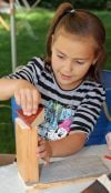 Morgan Gokey, 7, makes a wooden sculpture